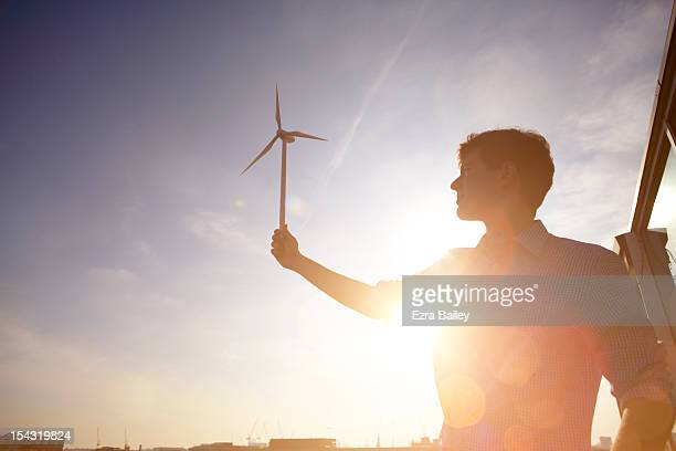 Man holding Wind turbine.