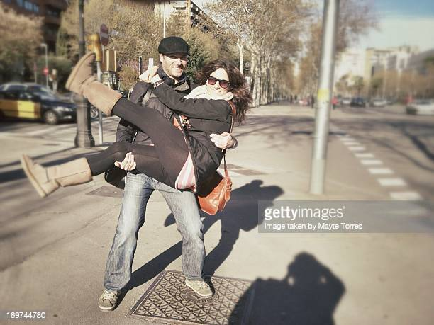 Man holding woman on the street