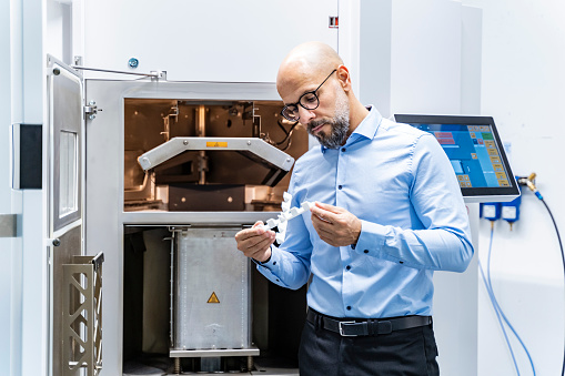 Man holding workpiece at 3d printer - gettyimageskorea