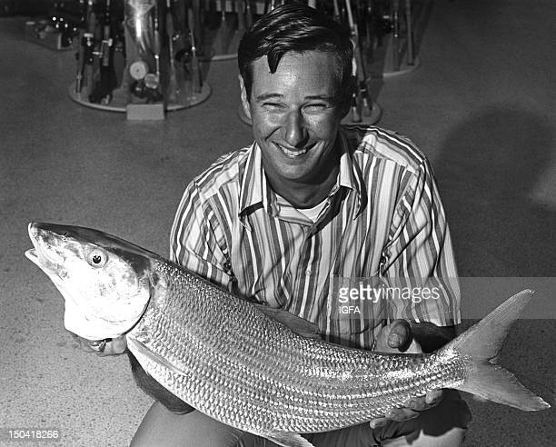 A man holds a 14 pound 4 ounce bonefish caught on 10 pound test line on January 5 1972 in Islamorada Florida