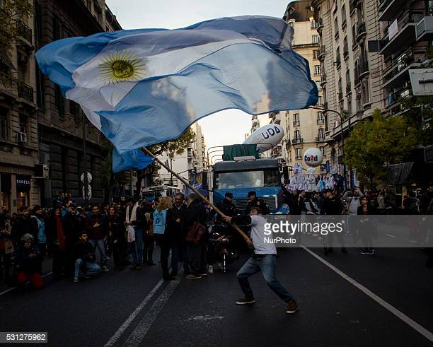 A man holds a Argentina��s flag during the student protest Universities stopped for the first time in 15 years to claim the government budgetary...