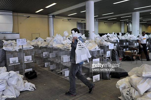 A man holds a bag filled with ballots in an election center in Thessaloniki on May 15 ahead of the local elections in Greece on May 18 Greece's...