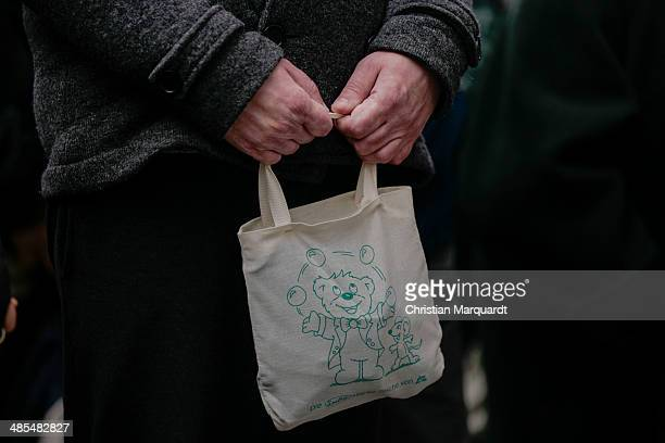 A man holds a bag with a painted bear on it during the ecumenical Good Friday procession on April 18 2014 in Berlin Germany Under the theme of...