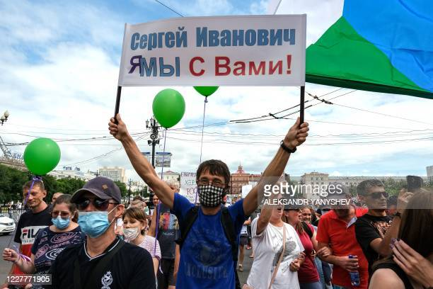 A man holds a banner during an unauthorised rally in support of Sergei Furgal the governor of the Khabarovsk region who was arrested in the Russian...
