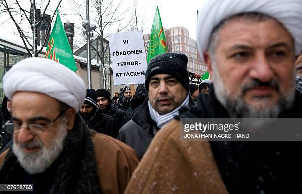A man holds a banner reading ''We condemn the terror attack'' on December 16 2010 in Stockholm during a demonstration called by muslims community...