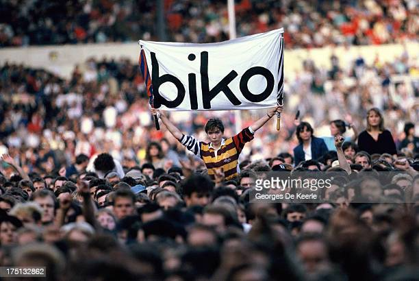 A man holds a banner saying 'Biko' during the 'Human Rights Now' concert in aid of Amnesty International held at Wembley Stadium on September 2 1988...