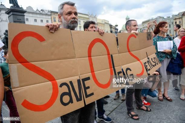 A man holds a banner saying Save Oleg Sentsov during the protest Protest demanding the release of the Ukrainian filmmaker and writer Oleg Sentsov at...