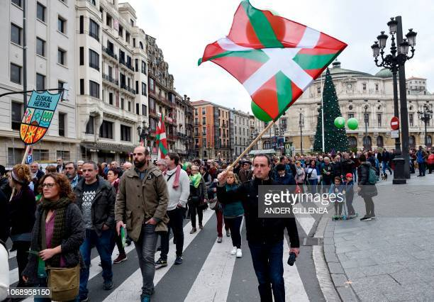 A man holds a Basque flag during a demonstration against the Spanish Constitution and in favor of a Basque Republic in Bilbao on December 6 on the...