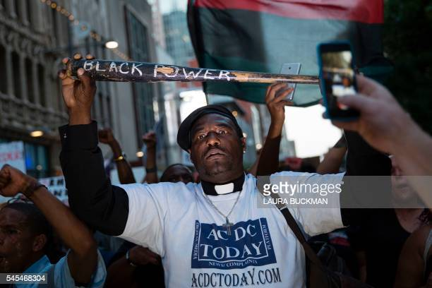 TOPSHOT A man holds a bat reading Black Power during a protest in Dallas Texas on Thursday July 7 2016 to protest the deaths of Alton Sterling and...