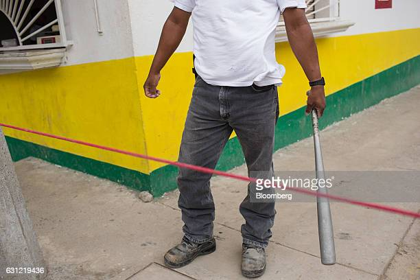A man holds a bat while standing guard near his home after looting in Veracruz City Mexico on Saturday Jan 7 2017 Mexico's National Association Of...
