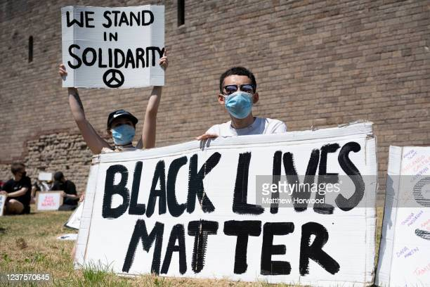 A man holds a 'black lives matter sign' during a protest outside Cardiff Castle in response to the death of George Floyd on May 31 in Cardiff Wales...