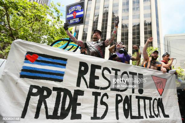 A man holds a 'Black Lives Matter' sign while participating in the annual LGBTQI Pride Parade on June 25 2017 in San Francisco California The LGBT...