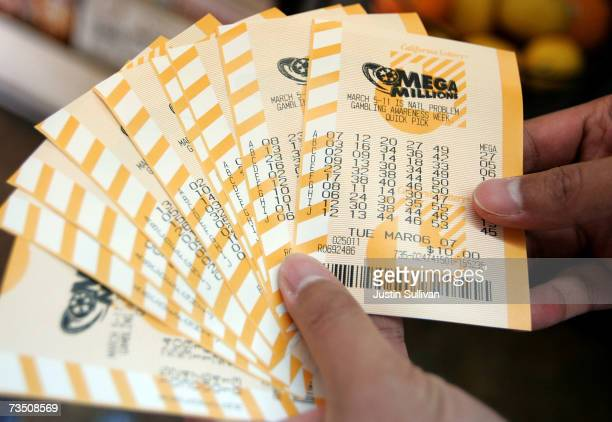 A man holds a bundle of Mega Millions lottery tickets that he just purchased March 6 2007 in San Francisco California The lottery jackpot was up to...