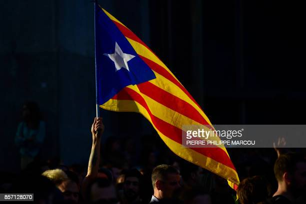 A man holds a Catalan proindependence 'Estelada' flag during a demonstration called by the General Confederation of Labour Catalan worker's union in...
