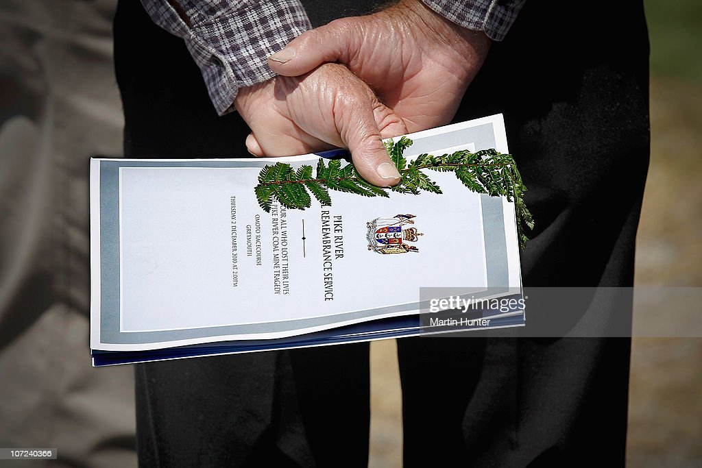 A man holds a copy of the Pike River Mine Official Remembrance Service booklet at a national memorial service for the 29 miners that lost their lives in the Pike River Mine at Omoto Racecourse on December 2, 2010 in Greymouth, New Zealand. Two Australians, two Britons, and a South African were amongst the 29 New Zealand mine crew that lost their lives following two blasts at the Pike River Mine 50 kilometers north of Greymouth on New Zealand's west coast.