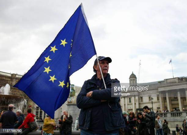 A man holds a European Union flag as thousands of demonstrators take to the streets of London during the People's Vote March on March 23 2019 in...
