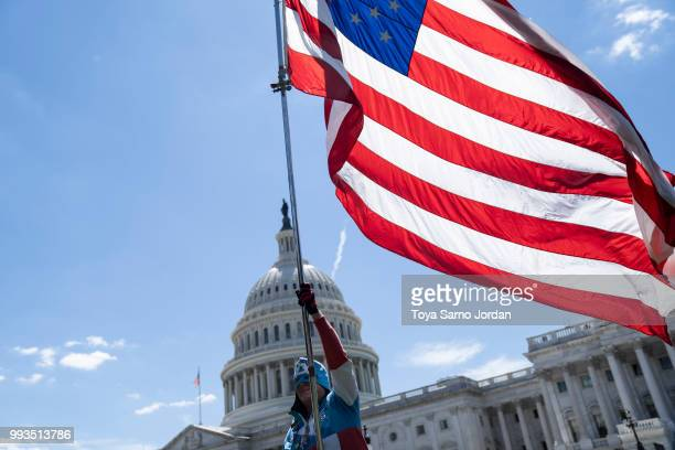 A man holds a flag during the March For Our Rights rally promoting Second Amendment Rights and the safety of students in schools outside the US...