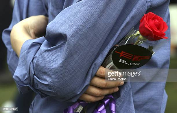 A man holds a flower and waits for a girl he dated during a matchmaking activity to mark the Singles Day November 11 2006 in Chongqing Municipality...