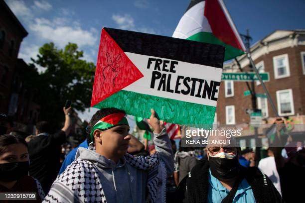 """Man holds a """"Free Palestine"""" sign during a demonstration in support of Palestine in Brooklyn, New York on May 15, 2021. - Pro-Palestinian..."""