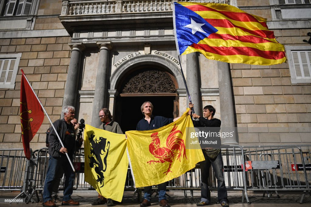 A man holds a independence flag outside the Palau Catalan Regional Government Building as Catalonia returns to work following last week's decision by the Catalan parliament to vote to split from Spain on October 30, 2017 in Barcelona, Spain. The Spanish government has responded by imposing direct rule and dissolving the Catalan parliament.