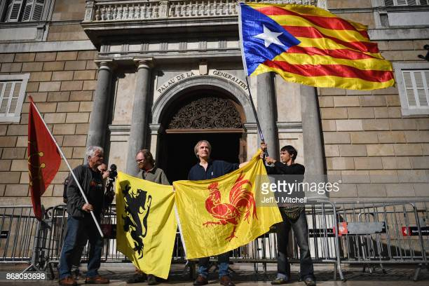 A man holds a independence flag outside the Palau Catalan Regional Government Building as Catalonia returns to work following last week's decision by...