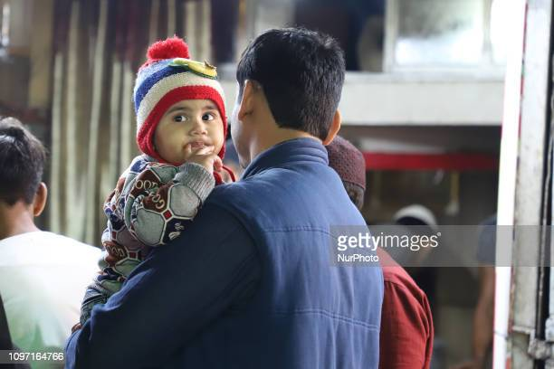 A man Holds a Kid outside Jama Masjid in the Old quarters of Delhi India on 10 February 2019