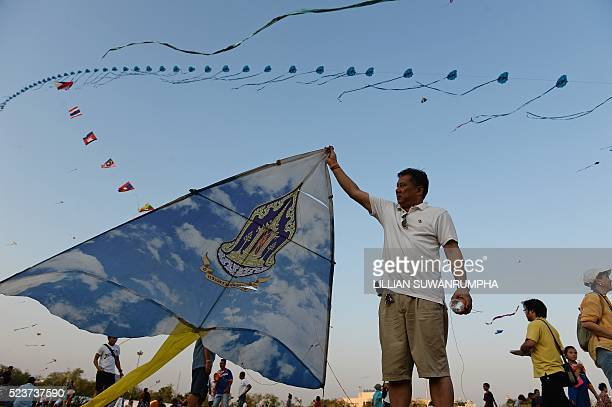 A man holds a kite in Sanam Luang park during The 234th Year of Rattanakosin City Under Royal Benevolence event in Bangkok on April 24 2016 The event...