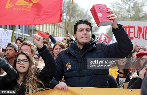 A man holds a Labour Code Code du travail while taking part in a nationwide day of protest against deeply unpopular labour reforms that have divided...
