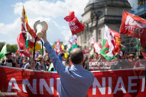 A man holds a loudspeaker to the crowd as thousands take part in the first ever march for Welsh independence from City Hall to the Hayes on May 11...