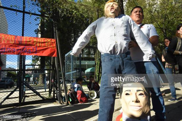 A man holds a mask of Donald Trump during the Mexicans meet outside the United States Embassy to plan a welcoming and gather donations for the...