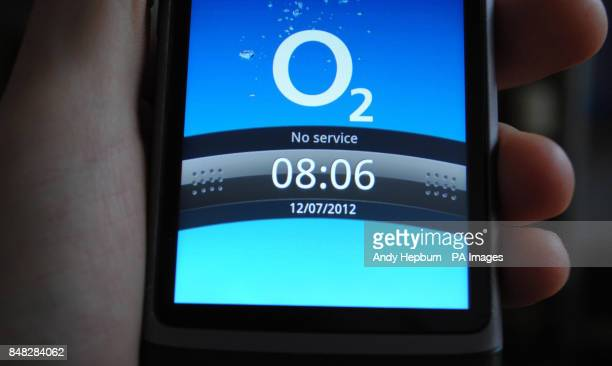 A man holds a mobile phone on the O2 network as hundreds of thousands of O2 customers were still unable to use their mobile phones after the...