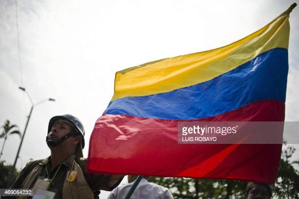 A man holds a national flag during the Peace Day in Cali Colombia on April 9 2015 The Colombian government is negotiating with the Marxistinspired...