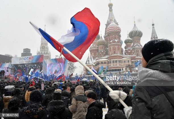 A man holds a national flag during the 'Russia is in my heart' rally in support of Russian athletes on February 3 2018 in central Moscow The IOC's...