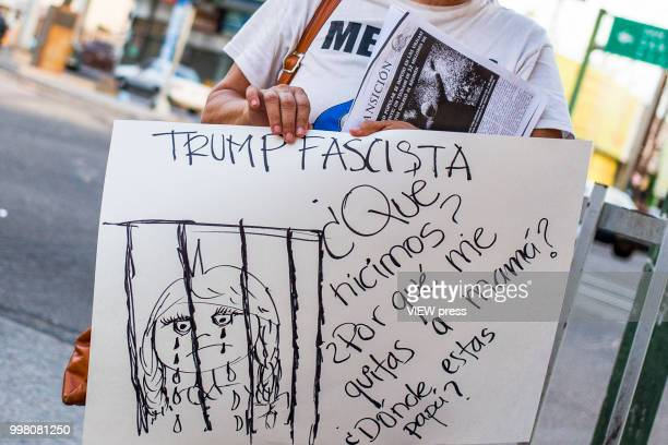 A man holds a placard as demonstrators take part in a protest against US president Donald Trump migration policies in the border between Mexico and...