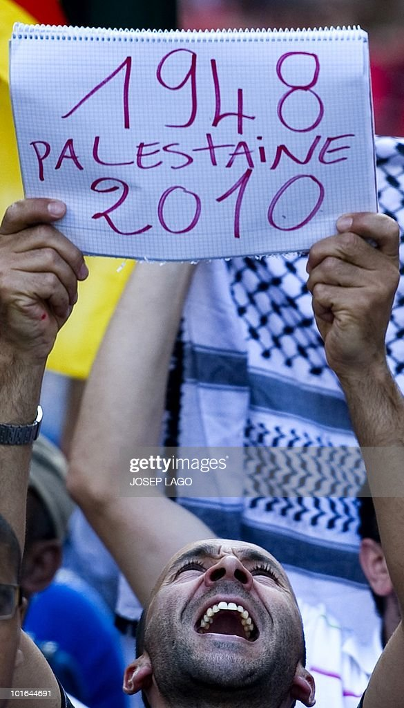 A man holds a placard during a demonstration anti-Israel in Barcelona on June 5, 2010 following a deadly Israel military raid Gaza-bound flotilla of aid ships on May 31. Spain, which holds the rotating EU presidency, condemned the Israeli army's raid on aid ships bound for Gaza and summoned Israel's ambassador.