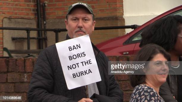 Man holds a placard during a protest, organized by Stand Up To Racism platform, against former British Foreign Secretary Boris Johnson after his...