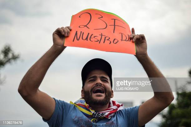 A man holds a placard reading 23F Our Day referring to February 23 the day set up by Venezuelan opposition leader and self declared acting president...