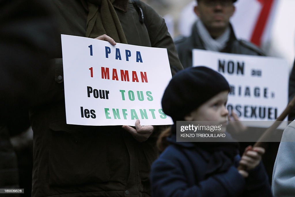 A man holds a placard reading 'A dad, a mom, for all children' during a protest organized by fundamentalist Christians group Civitas Institute against same-sex marriage on April 4, 2013 in front of the French Senate in Paris on the first day of the debate at France's upper house on the controversial bill to legalise same-sex marriage and adoption. While the upper house is unlikely to reject the groundbreaking reform, it is still expected to be a tight vote as the ruling Socialists enjoy a smaller majority in the Senate than in the National Assembly.