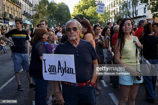 A man holds a placard reading 'I am Aylan' as he takes part in a demonstration to show solidarity and support for refugees on September 12 2015 in...