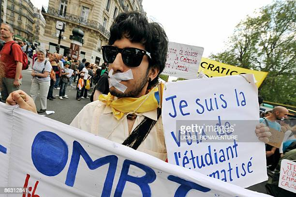 A man holds a placard reads in French 'I'm the voice of students' during the traditional May Day demonstration on May 1 2009 in Paris as leftwing...