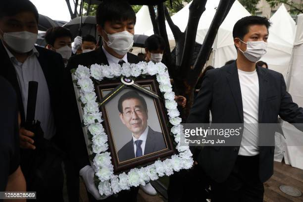 Man holds a portrait of deceased Seoul Mayor Park Won-soon during the funeral service at City Hall Plaza on July 13, 2020 in Seoul, South Korea. Park...