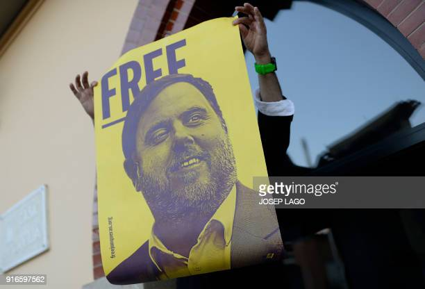 A man holds a poster depecting Catalonia's jailed former vice president Oriol Junqueras during a demonstration marking 100 days of Junqueras´arrest...