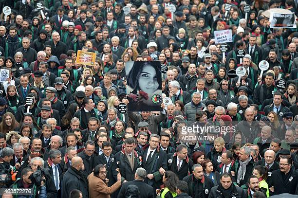 A man holds a poster depicting slain Ozgecan Aslan during a march of members of Turkey's Bar Association in Ankara on February 16 2015 to protest...