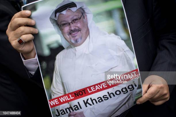 A man holds a poster of Saudi journalist Jamal Khashoggi during a protest organized by members of the TurkishArabic Media Association at the entrance...