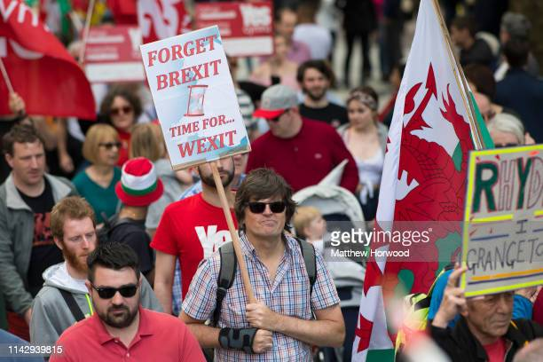 Man holds a sign as thousands take part in the first ever march for Welsh independence from City Hall to the Hayes on May 11, 2019 in Cardiff, Wales....