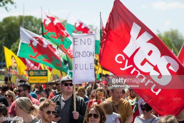 A man holds a sign as thousands take part in the first ever march for Welsh independence from City Hall to the Hayes on May 11 2019 in Cardiff Wales...