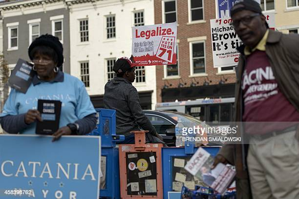 Man holds a sign for Ballot Initiative, the legalization of marijuana, on November 4, 2014 in Washington, DC. Voters around the United States went to...