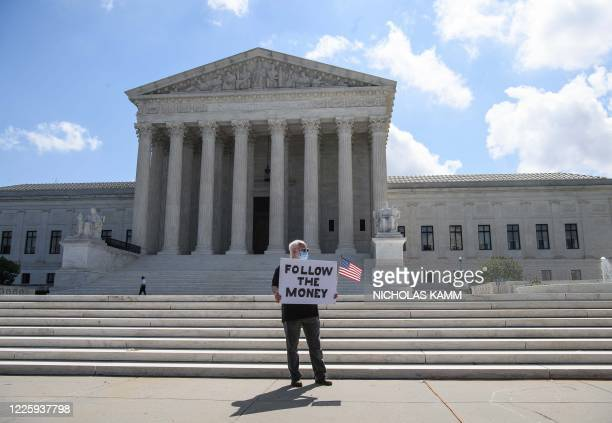 TOPSHOT A man holds a sign in front of the US Supreme Court in Washington DC on July 9 2020 The court ruled that US President Donald Trump must hand...