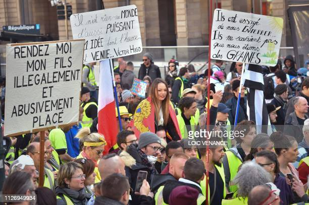 A man holds a sign reading Give me back my son illegaly and abusively placed as members of the yellow vest take part in the 15th consecutive Saturday...