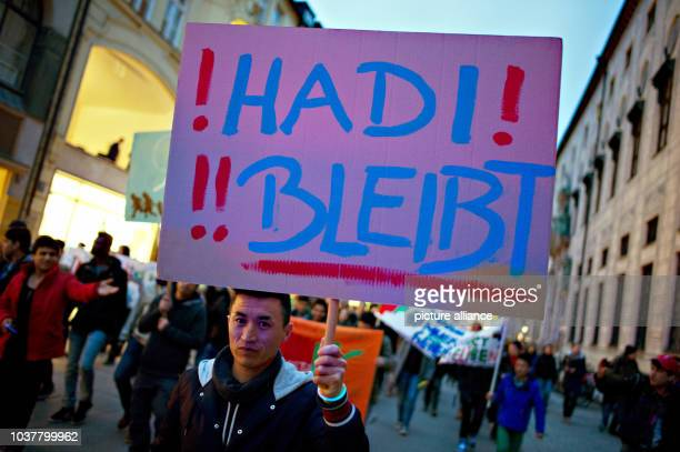 A man holds a sign reading 'Hadi stays' which refers to the recent case of 22yearold Hadi Arefi from Dachau who shall be deported to Afghanistan...